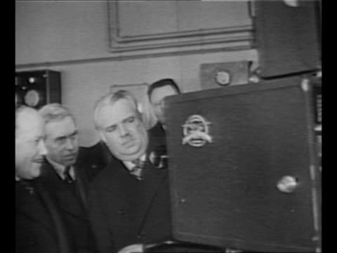 men examine motion picture camera in inventor louis lumiere's laboratory in paris france / elderly lumiere smiles as he stands with his motion... - lumière stock videos & royalty-free footage