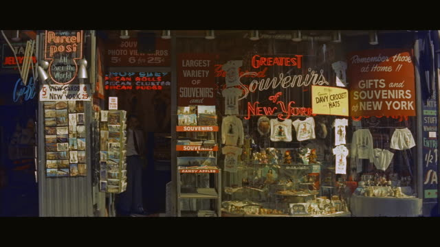 ms men exiting and checking products in souvenir shop / new york city, new york state, united states  - postcard stock videos and b-roll footage