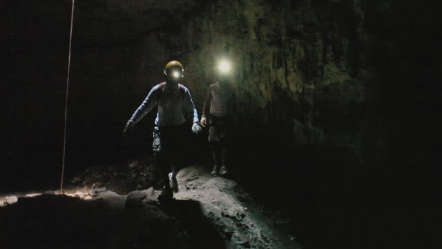 ws men exploring cave, yucatan, mexico - electric torch stock videos & royalty-free footage