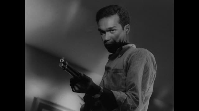 vidéos et rushes de 1968 men fight desperately with shotgun before one shoots the other - tuer