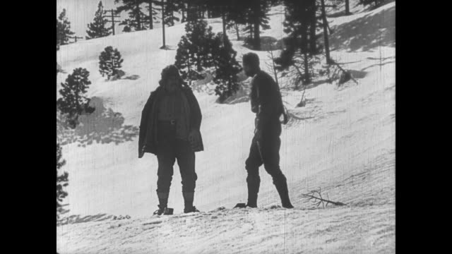1922 men fight in snow until one is stabbed and the other is stuck upside down - knife weapon stock videos & royalty-free footage