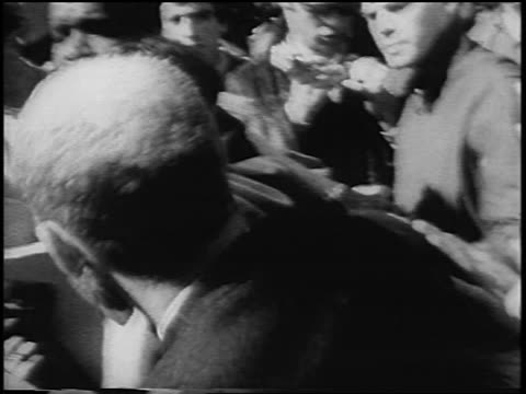 b/w 1967 2 men fighting in antiwar demonstration in kezar stadium / san francisco / newsreel - peace demonstration stock videos and b-roll footage