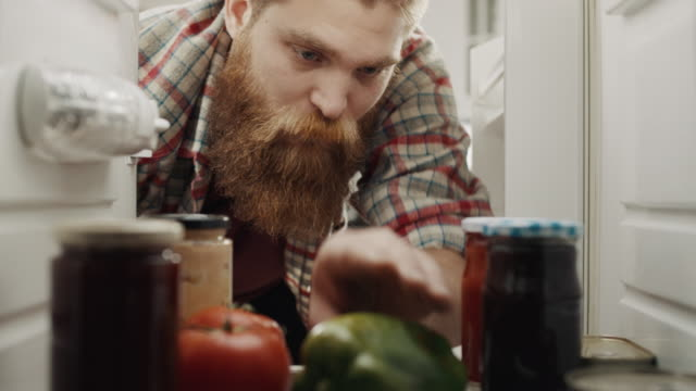 men filling refrigerator with groceries - full stock videos & royalty-free footage