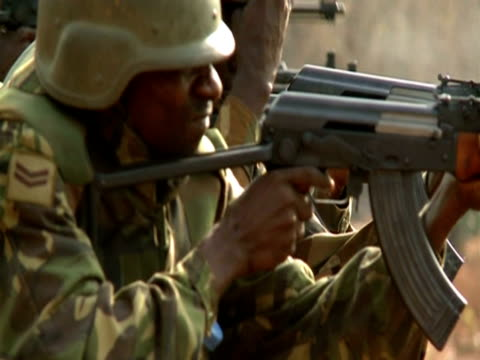 men fire guns during military training in sierra leone - sierra leone stock videos & royalty-free footage