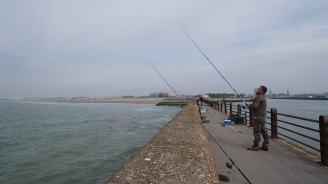 men fish for sea bass from the 'jetée de malo' on may 28, 2021 in dunkirk, france. from may 26 till june 4 1940 the pier was used for the dunkirk... - tranquil scene stock videos & royalty-free footage