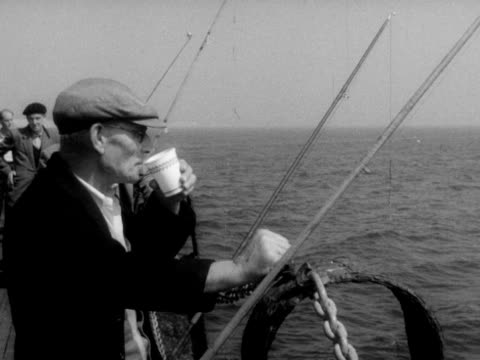 men fish off brighton's palace pier. - brandungsfischen stock-videos und b-roll-filmmaterial