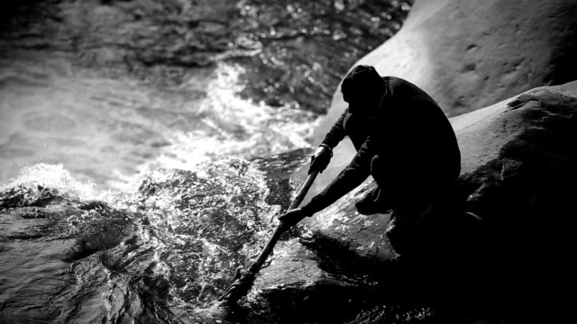 men fishing in the flowing water - gold rush stock videos and b-roll footage