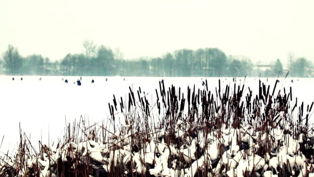 men fishing on the frozen lake - tights stock videos & royalty-free footage