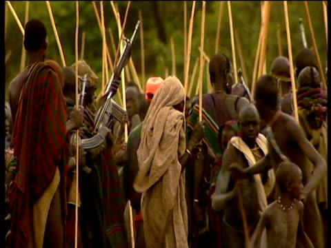 men flee gunfire during donga stick fighting festival suri territory ethiopia - runaway stock videos & royalty-free footage