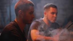 Men friends smoking hookah playing backgammon
