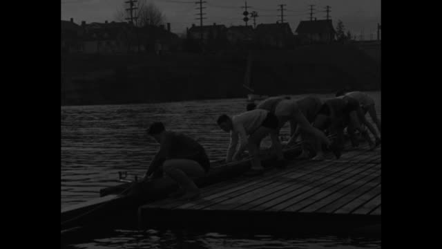 men from university of washington carrying boats to water / cu oarsman don hume / coach al ulbrickson leads 6 boats in practice / note exact day not... - university of washington stock videos & royalty-free footage