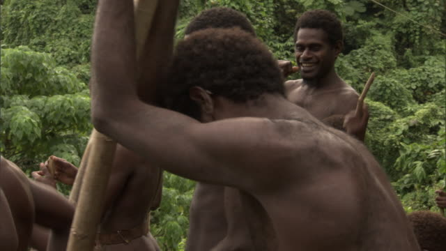 Men gather during land diving ritual, Pentecost, Vanuatu