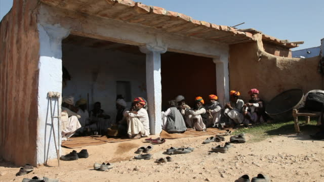 ws men gathered for a opium ceremony / rajasthan, india - ceremony stock videos and b-roll footage