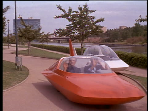 vídeos de stock e filmes b-roll de men getting out of futuristic car outdoors - estilo retro