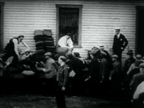 b/w 1932 men giving blankets to wwi veterans in washington dc for bonus march - 1932 stock videos & royalty-free footage