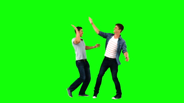 men giving highfive in slow motion - gestikulieren stock-videos und b-roll-filmmaterial