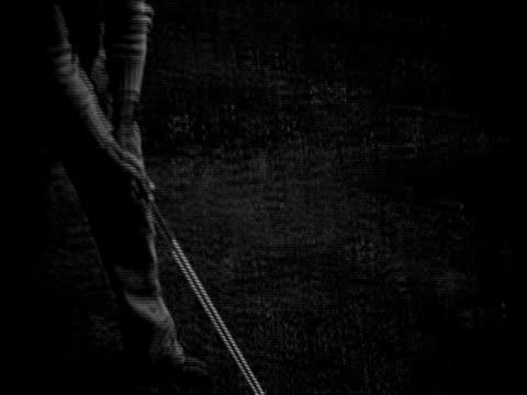 vídeos y material grabado en eventos de stock de men golfing - putt
