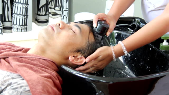 men hair washing by women - hairstyle stock videos and b-roll footage