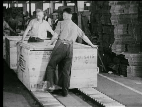 b/w 1927 2 men hammering crate / industrial - 1927 stock videos & royalty-free footage
