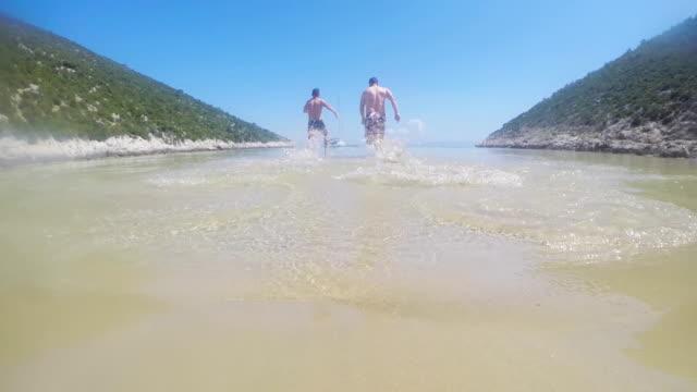 LS Men Having Fun In Shallow Water