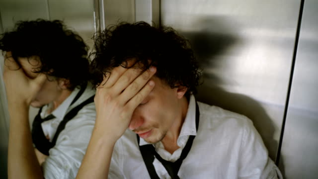 men having panic attack in elevator - paranoia stock videos & royalty-free footage