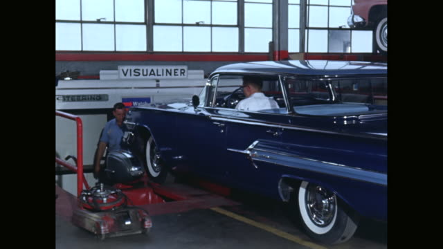 ms men helping car rider to position the car on hydraulic lift in garage / new york city, new york state, united states - hydraulics stock videos and b-roll footage