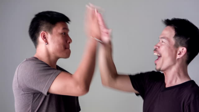 hd dolly : men high five for successful - asian colleague stock videos & royalty-free footage
