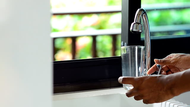 men hold glass to drink fresh water - sideways glance stock videos & royalty-free footage