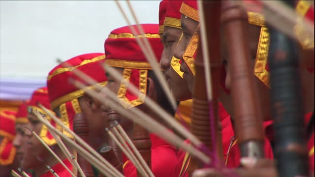 stockvideo's en b-roll-footage met men hold incense during a blessing ceremony in thailand. - men
