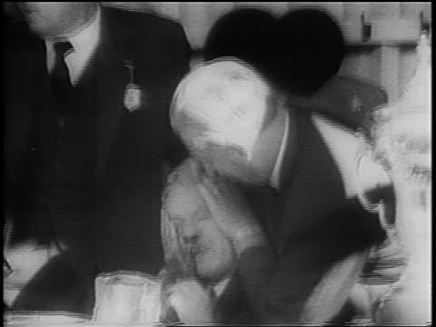 vidéos et rushes de b/w 1960 men holding bleeding prime minister hendrik verwoerd after shooting / south africa - apartheid