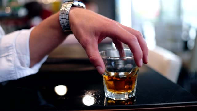 men holding glass of whiskey - one man only stock videos & royalty-free footage