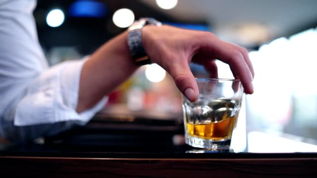 men holding glass of whiskey - scotch whiskey stock videos and b-roll footage