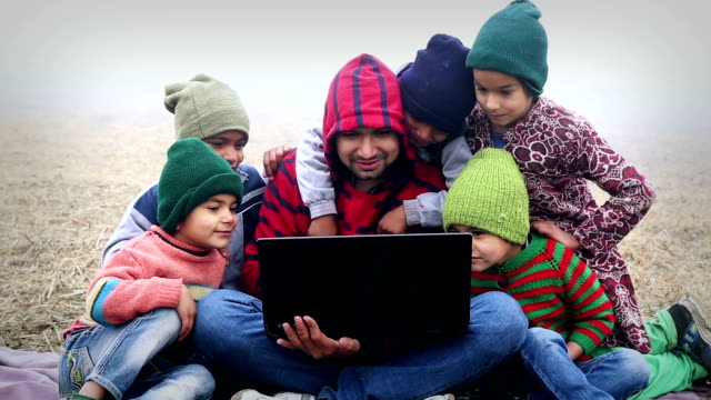 men holding laptop with little kids - child sitting cross legged stock videos & royalty-free footage