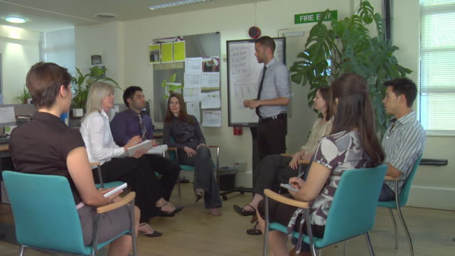 WS Men holding meeting in office / London, UK