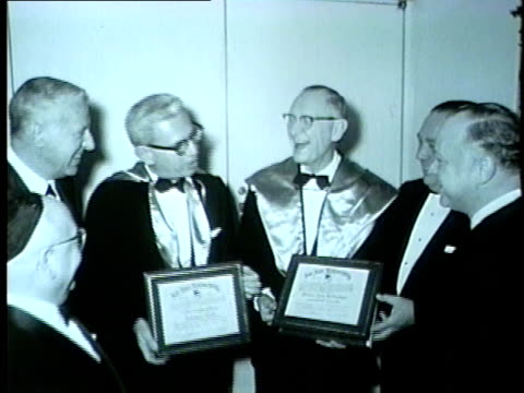 men honored at abanquet in chicago in 1962 - anno 1962 video stock e b–roll