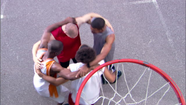 men huddling at basketball court - see other clips from this shoot 1281 stock videos and b-roll footage
