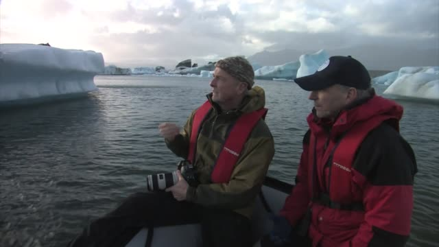 men in a boat among icebergs. editorial use only. - photographer stock videos & royalty-free footage