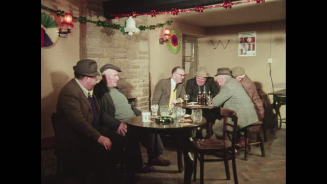 men in a pub at christmas, uk, 1970s - beer alcohol stock videos & royalty-free footage