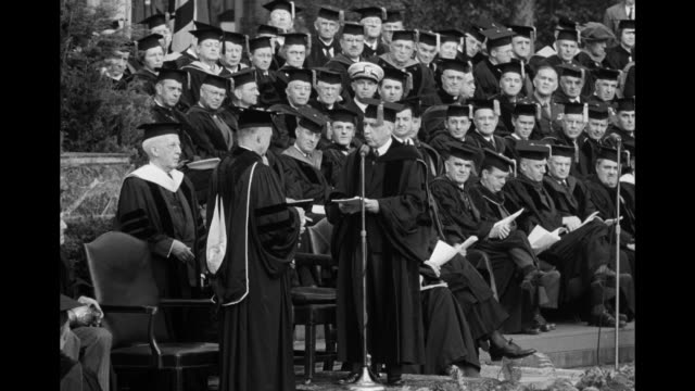 men in academic regalia on podium at columbia university graduation, one hands the other a paper in ceremony held in front of low memorial library /... - ivy league university stock videos & royalty-free footage