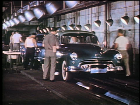 1947 men in assembly line inspect completed 1948 oldsmobiles / man puts sticker on windshield - horseless carriage stock videos & royalty-free footage