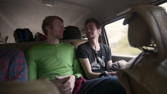men in backseat - vehicle interior stock videos & royalty-free footage