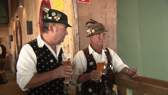 men in bavarian costumes with beer