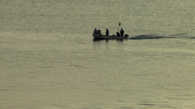 WS HA Men in boat on open water, Ecuador