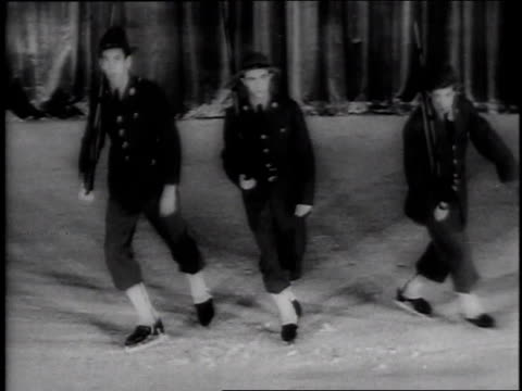 1944 montage men in civil war uniforms doing a comedic ice skating routine / new york city, new york, united states - ice skating stock videos & royalty-free footage