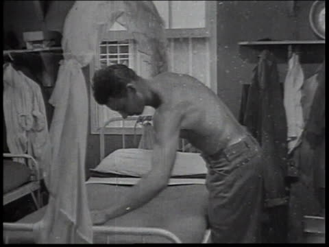 1934 montage men in civilian conservation corps barracks making beds in the military style / united states - new deal video stock e b–roll