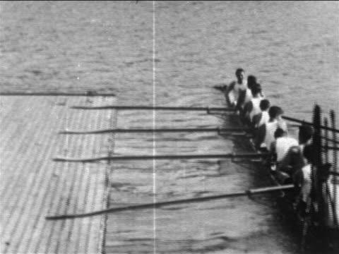 B/W 1905 men in crew boat taking off from dock / Philadelphia / newsreel
