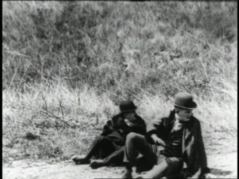 b/w 1925 2 men in derbies standing up, looking down in fright/shock (2 shots) / feature - anno 1925 video stock e b–roll