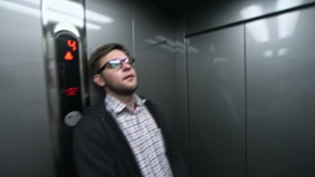pov of men in elevator - part of a series stock videos & royalty-free footage