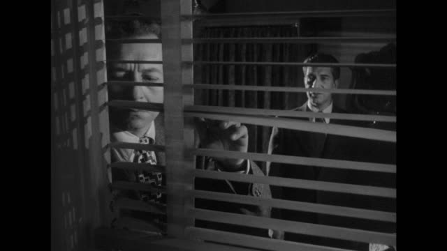 1948 men in hiding look out hotel window - film noir style stock videos and b-roll footage