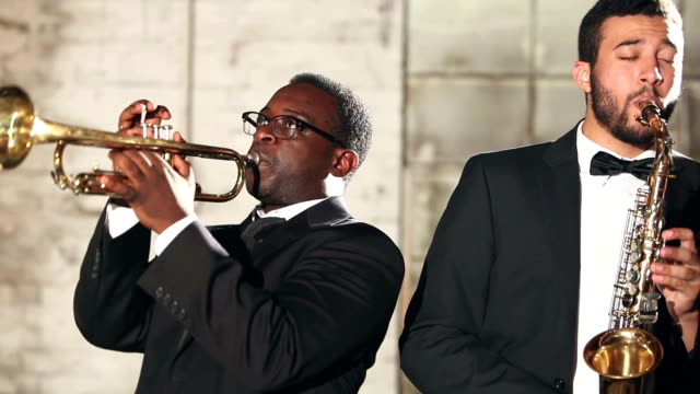 men in jazz band on trumpet and saxophone - performance group stock videos and b-roll footage